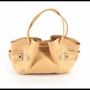 Camel colored Cole Haan purse with a pink lining